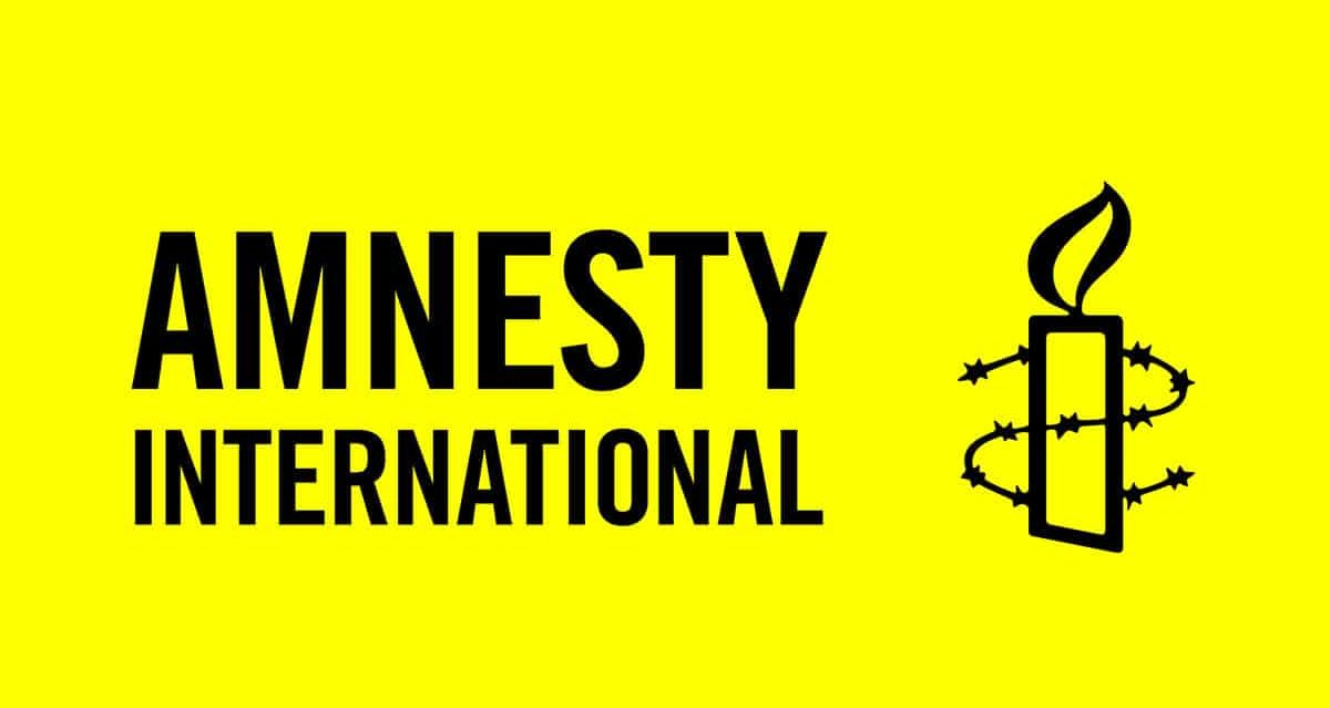 Amnesty International logo yellow