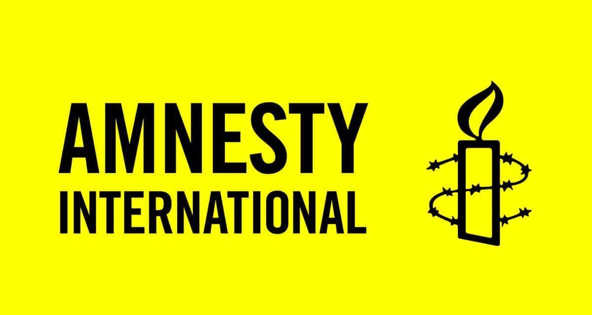 Amnesty International logo yellow