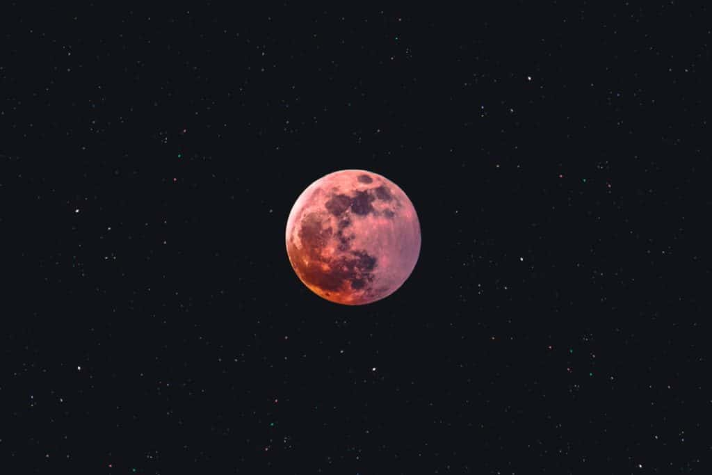 red moon on a starry sky
