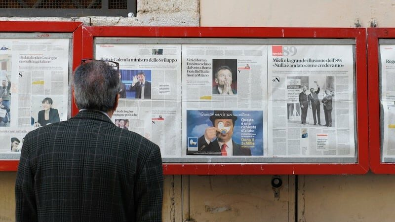 Man reading newspaper hero image