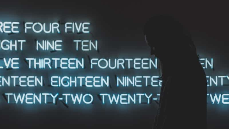 Hero image of neon numbers with a focus on 9