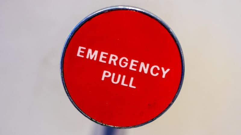 Hero image of an emergency pull button to represent crisis