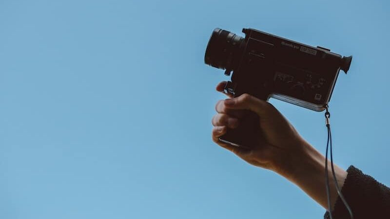 Hero image of a person holding a camera