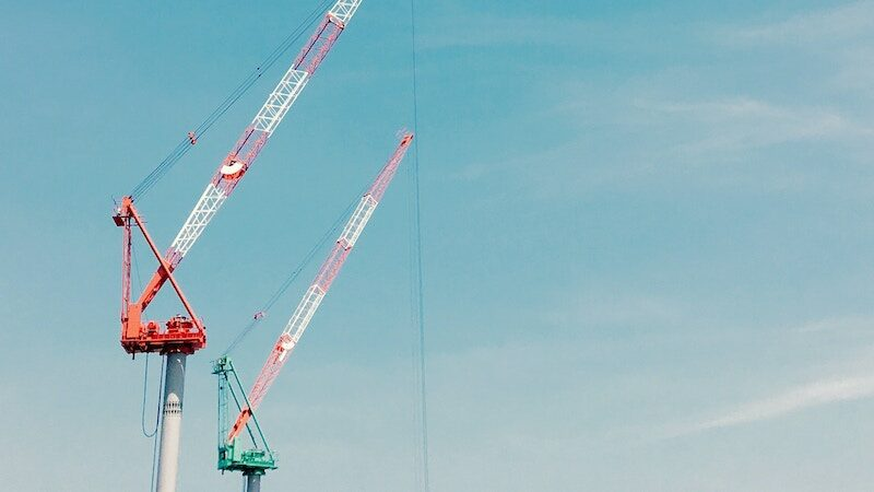 Hero image of cranes in construction