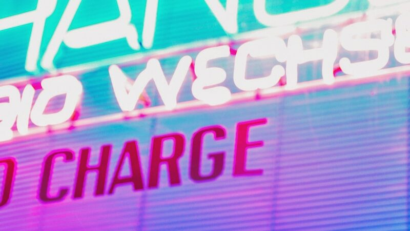 Hero image of a neon sign that says 'Charge'