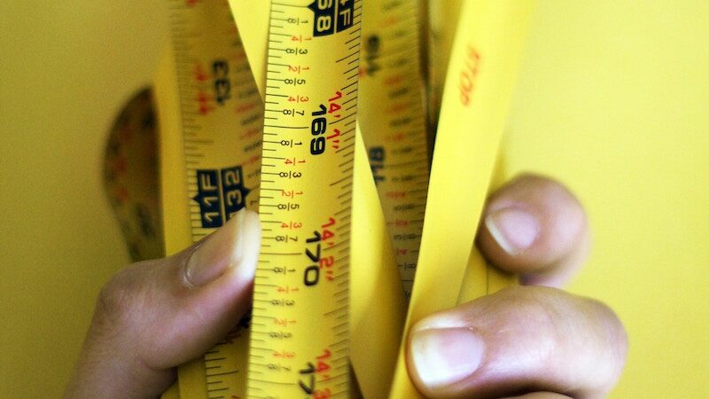 Hero image of a woman holding measuring tape