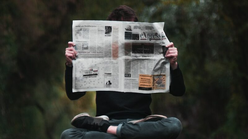 Hero image of floating man holding a newspaper