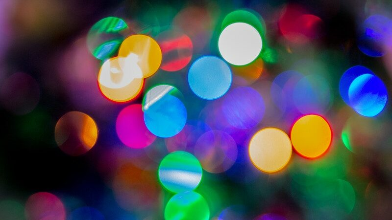 Hero image of blurred Christmas lights for PR news roundup